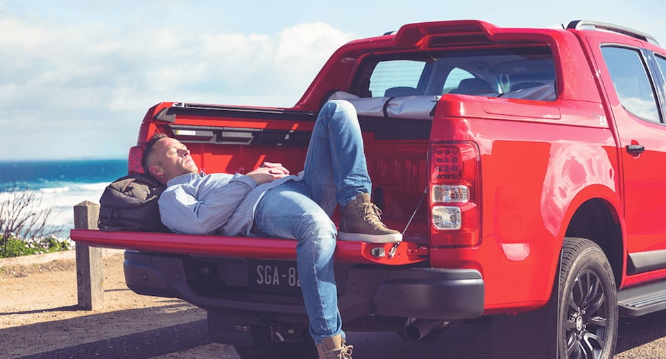 A Man Lying in a Truck Bed