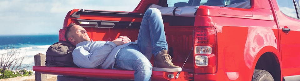 Man Lying on the Bed of a Truck